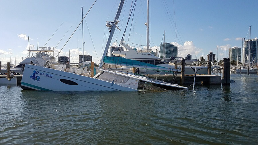 Partially submerged catamaran at dock.